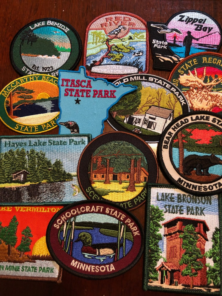 Close up photo of part of Ruth's Minnesota State Park patch collection.
