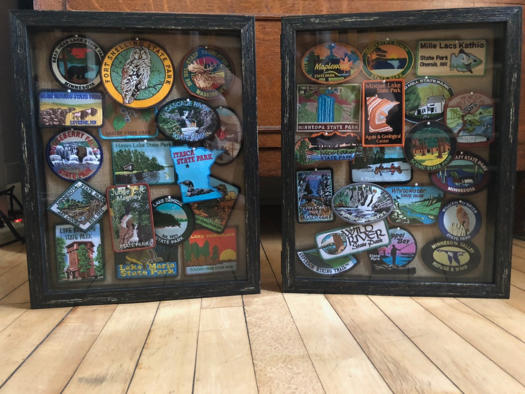 Two display cases filled with Minnesota State Park Patches