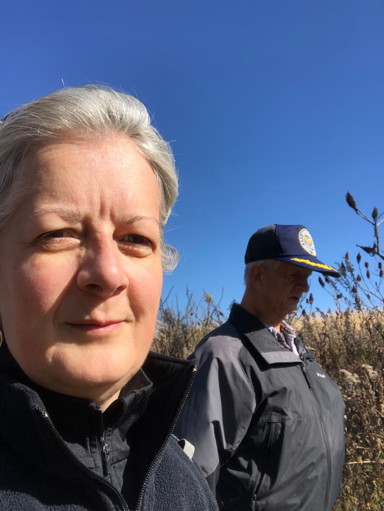 Ruth in left of photo with her dad on the right in the background while hiking at Frontenac State Park.