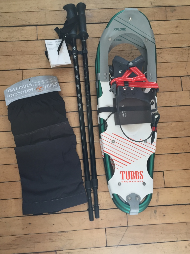 Photo of the Tubbs Explore 25 snowshoes, trekking poles and gaiters that I purchased for snowshoeing.