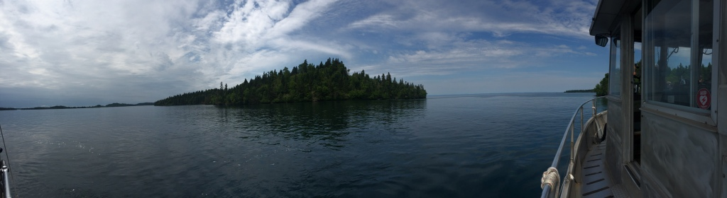 A panoramic photo of Isle Royale from the ferry as it leaves the island. The ferry cabin is to the right of the image.