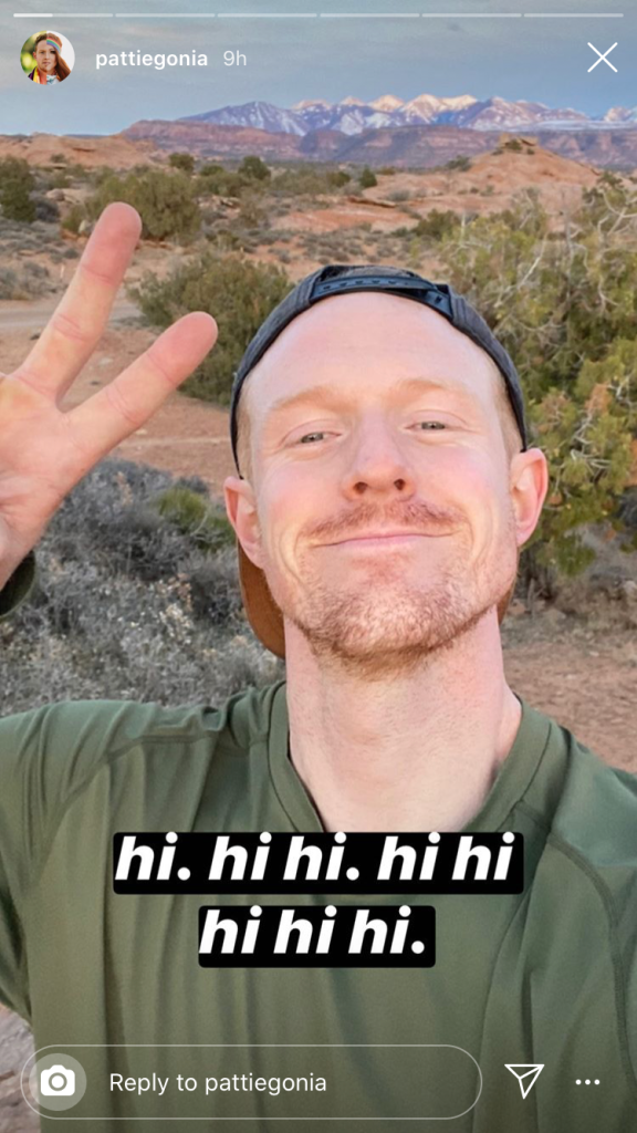 A screen shot of a post by Pattie Gonia, hiking persona and outdoors advocate for LGBTQ inclusion in the outdoors community. The image is of photographer Wyn Wiley in the desert near Moab, Utah with the word hi repeated across the bottom of the image.