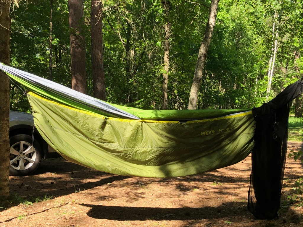 The image shows the hammock with the green Ember™ UnderQuilt attached.
